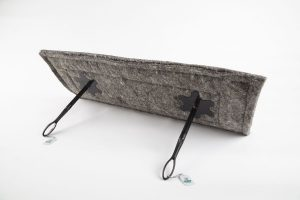 "14"" x 36"" woolen chimney sheep draught excluder with two clamps and handles against a white background."