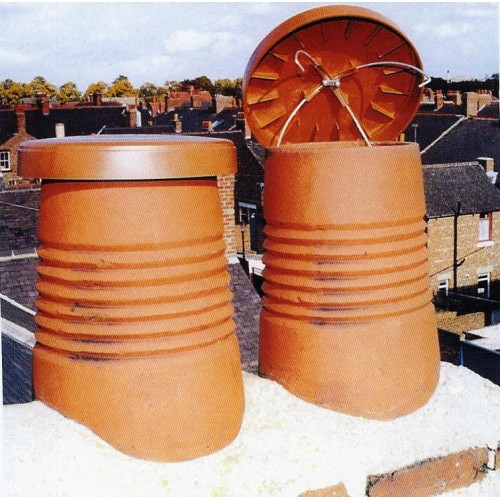Chimney Pots with chimney caps covereing them -C Caps