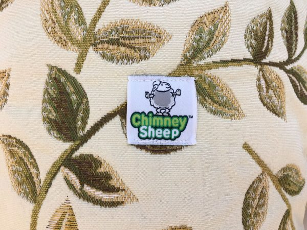 swirly green leaves door draught excluder with chimney sheep logo label