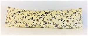 A door draught excluder - colour cream with pretty purple and yellow flowers