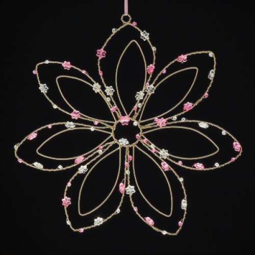 beaded white wire flower on a black background