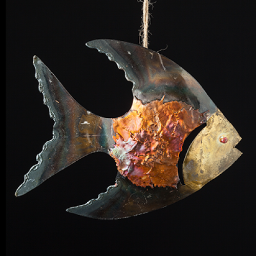 iridescent tin and copper fish dangle on a black background