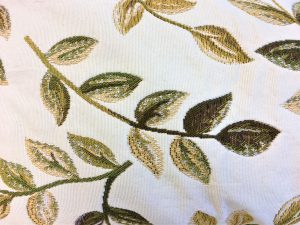 swirly green leaves fabric for door draught excluder close up