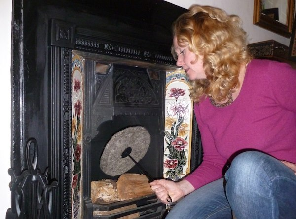 Sally installing a Chimney Sheep draught excluder