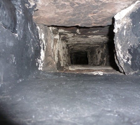 Looking up a fireplace into the chimney