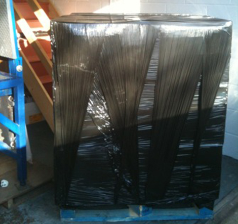 A Pallet of tools wrapped with black shrink wrap