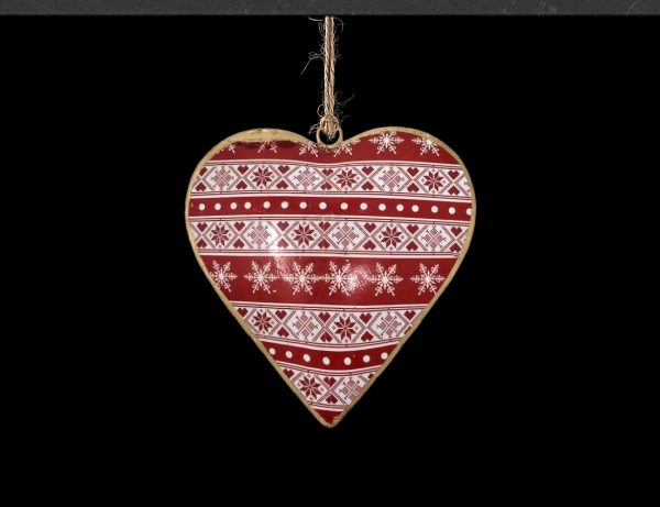 A single nordic heart dangle, painted witha red and white winter inspired design infront of a black background