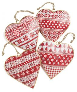 Four painted metal nordic hearts with winter insipred designs, red and white.
