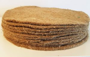 a stack of ten felted jute tree mulch mats. These are a pile of 13.5 inch or 35 centimetre diameter discs