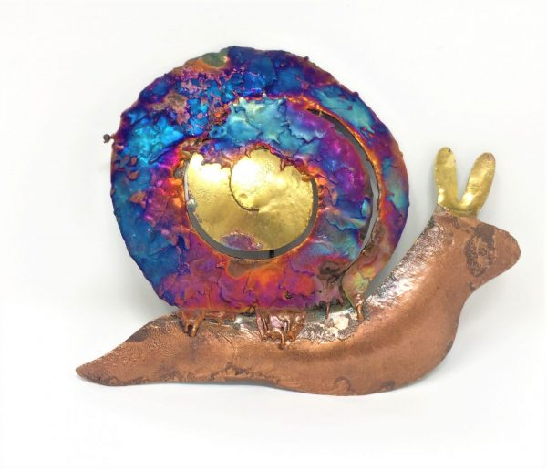Copper ornamental snail with copper coloured body and iridescent blues, purples, orange and gold on the curly shell