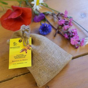 beebomb bag of seedballs with multi-coloured flowers