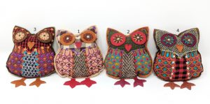 four tweedy dangly owls in a row