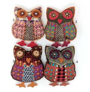 four tweedy dangly owls with numbers so customers can choose which one they like