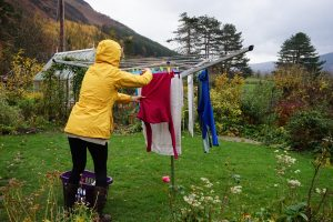 hanging laundry in the rain