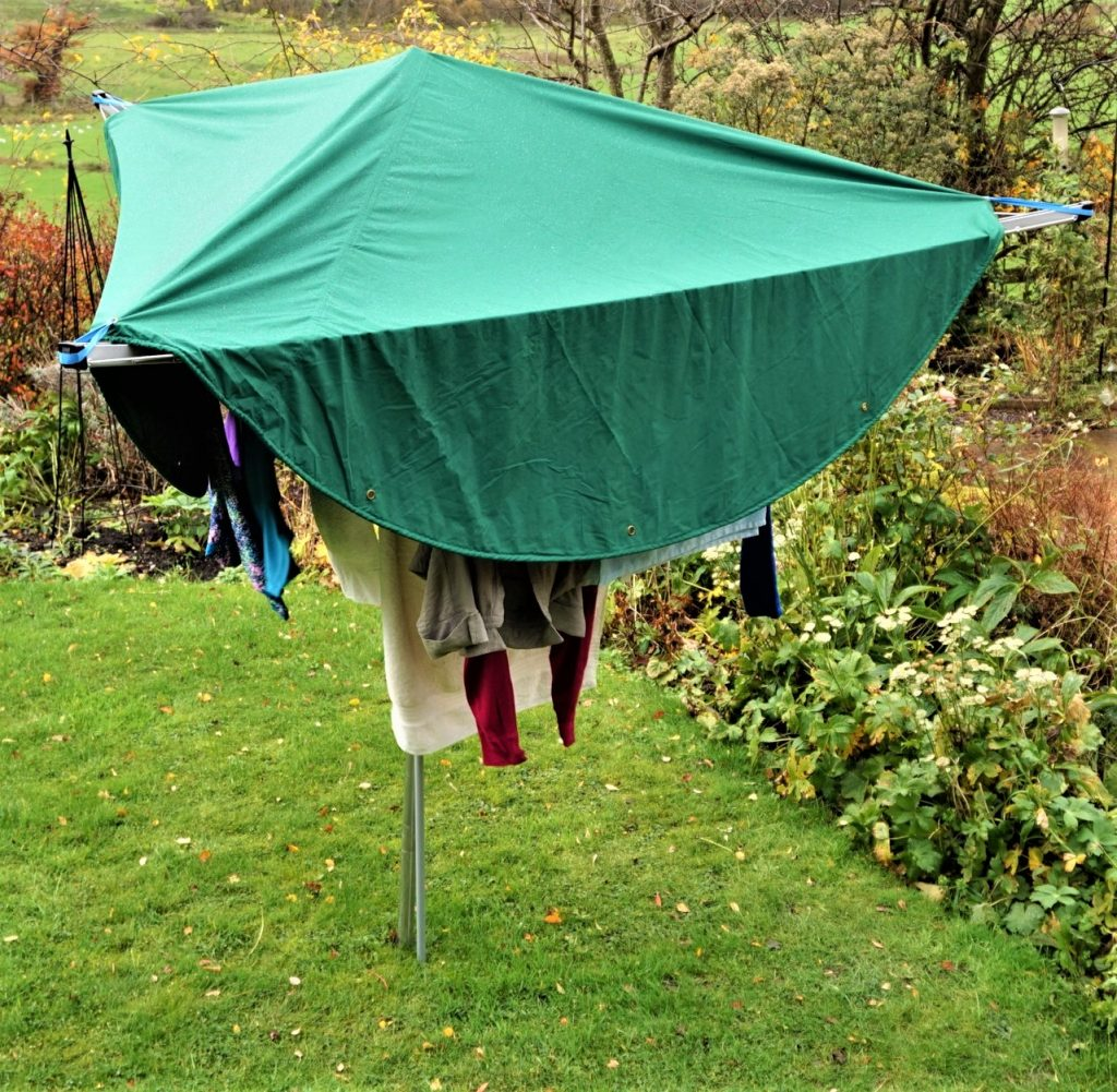 Laundry Mac is hung over laundry to protect it from rain showers and let it dry outside