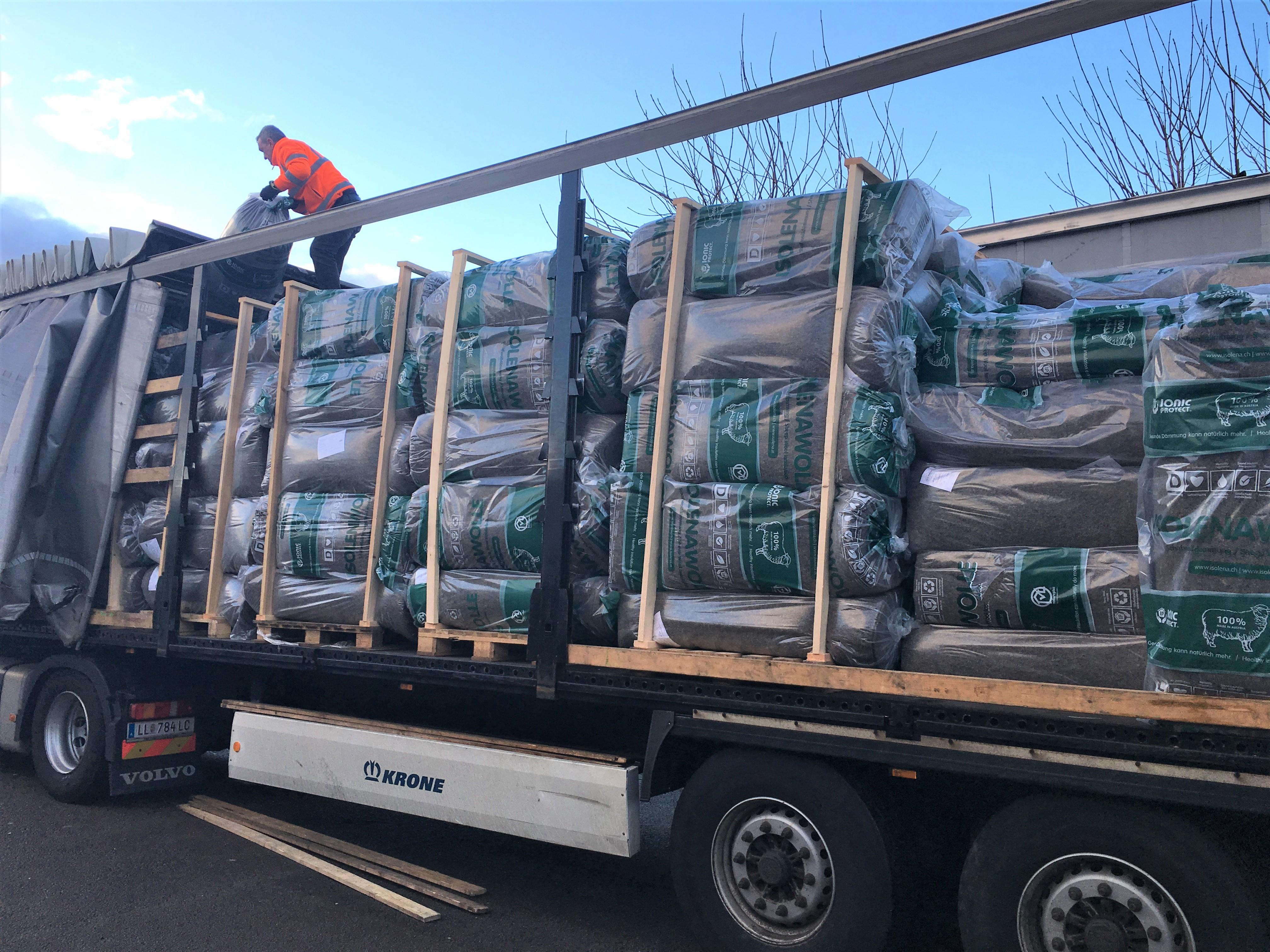 unloading lovely rolls of felted Herdwick wool