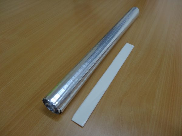 Radiator foil on a roll with image of sticky pads that are included in the pack