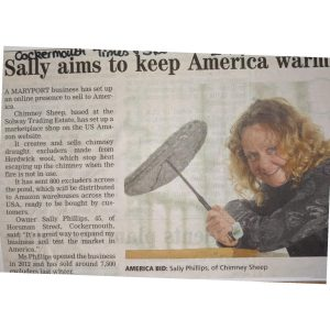 Article of Sally holding Chimney sheep - article on Chimney Sheep expansion into the USA