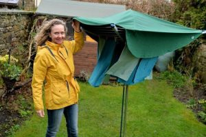 Sally Phillips showing the Chimney Sheep Laundry Mac clothes protector