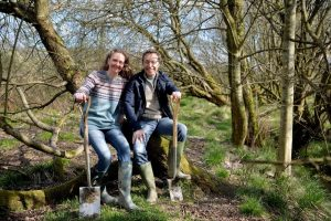 Sally Phillips and Darren Ward sat in Chimney Sheep's field used to plant trees