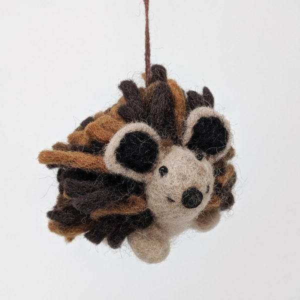 Chimney Sheep Woolly felted hedgehog dangling on a white background