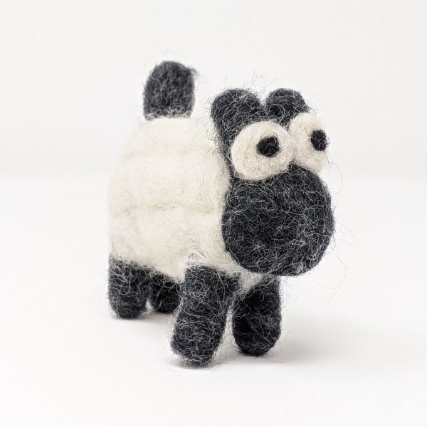 woolly felted sheep on white background chimney sheep
