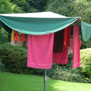 Large Laundry Mac™ for large four armed rotary dryer sheltering load of washing on the line