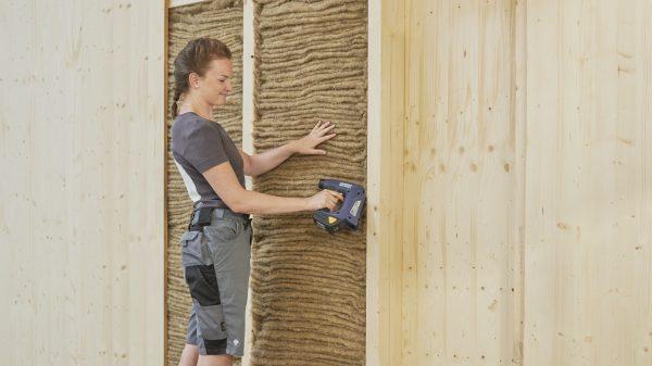Premium sheep wool insulation being applied inbetween wall joists