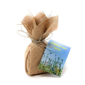 wildflower seed balls wrapped in jute with an attractive picture of wildflowers on the label