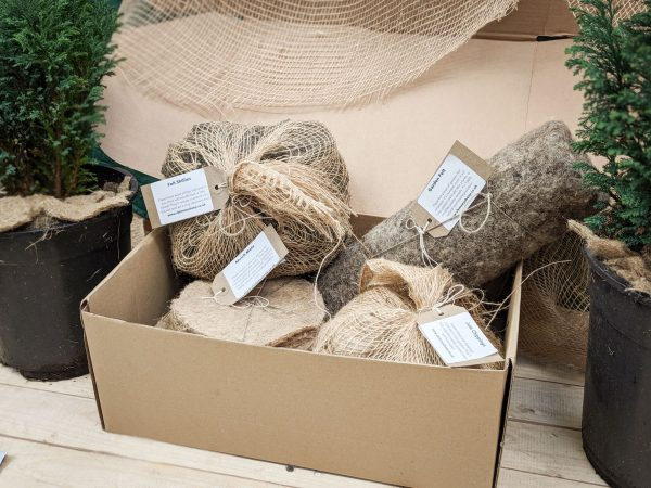 gardeners natural mulch selection pack in recycled cardboard box with fir trees to make it look lovely