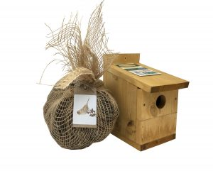 multi nester bird box with bundle of sheep wool for nesting birds next to it